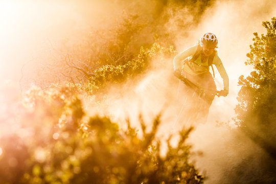 Female moutainbiker riding on dirt path during sunset, Fort Ord National Monument Park, Monterey, California, USA