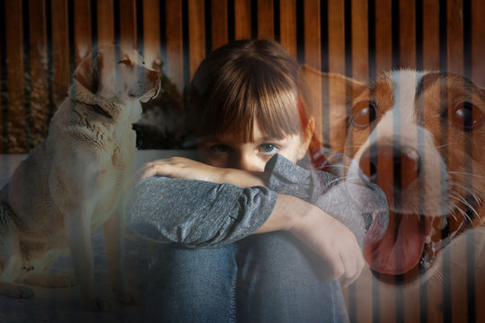 Cynophobia concept. Double exposure of scared little girl and dogs