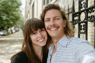 Young couple smiling together for a picture