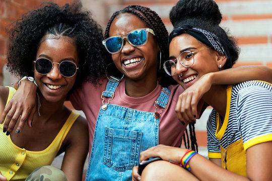 Three african Girl Friends. Three little friends hug each other