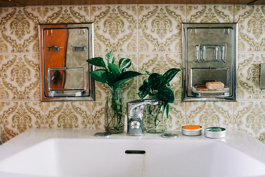 Vintage bathroom with plants and eco friendly soap