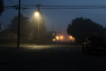 Foggy morning intersection in a small rural town Fotomurales