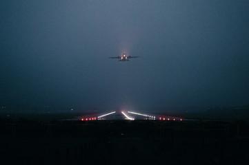 Commercial Jet Departing In The Fog Fotoväggar
