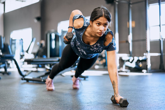 Fit woman working out in a gym