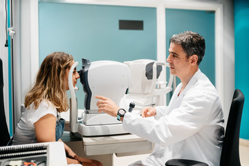 Oculist checking patient's eyes pressure, tonometry