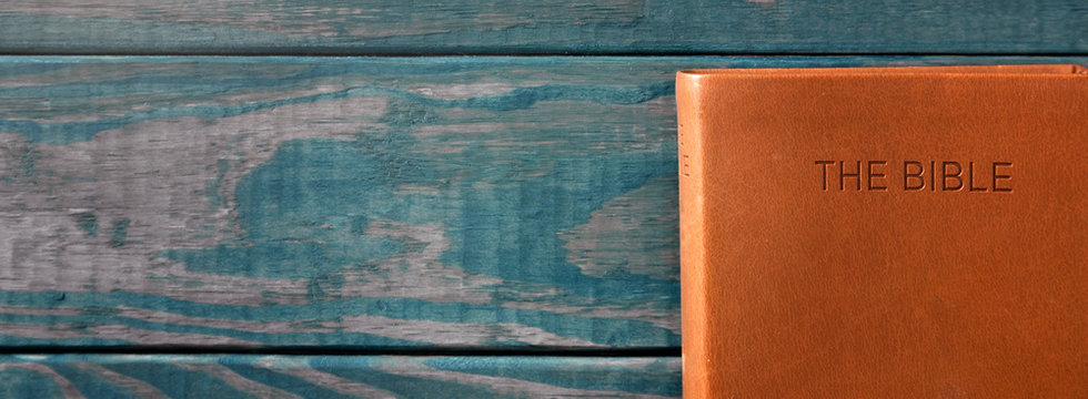 A Background with a Bible on a Rustic Wooden Table