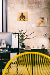 Stylish Studio Interior With Erotic Photos on Wall