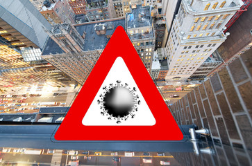 Wall Mural - New York City, USA. Concept image with large red coronavirus warning sign with Manhattan night skyline, travel restriction concept, covid-19 virus outbreak