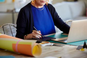 Senior woman using drawing pen tablet