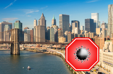 Wall Mural - New York City, USA. Concept image with large red coronavirus warning sign in front of Manhattan skyline and Brooklyn Bridge, travel restriction concept, covid-19 virus outbreak