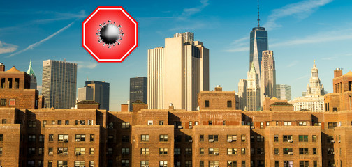 Wall Mural - New York City, USA. Concept image with large red coronavirus warning sign in front of Manhattan skyline, travel restriction concept, covid-19 virus outbreak