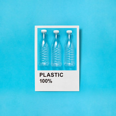 Plastic bottles in a frame on a blue background