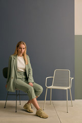 Blond Woman Posing On Chair
