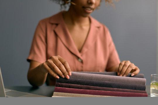 Female Designer Choosing Upholstery