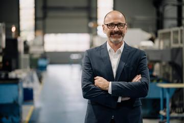 Portrait of a confident businessman in a factory