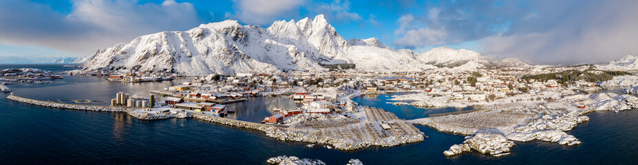 Norway, Ballstad, Aerial panorama of fishing village on shore of?Vestvagoya?island with mountains in background Fotobehang