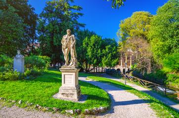 Farnese Hercules (Ercole Farnese) ancient statue of Hercules in Salvi gardens park with green trees and lawn, Valmarana Lodge building, historical city centre of Vicenza city, Veneto region, Italy Fototapete