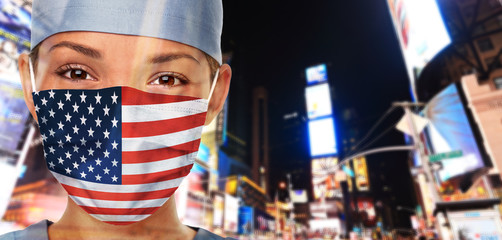 USA Coronavirus outbreak COVID-19 American Asian woman wearing mask in the United States of America flag print on doctor's mask smiling in confidence giving hope . New York City. Fotomurales