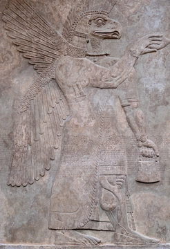 Ancient persian bas-relief depicting a winged god with the head