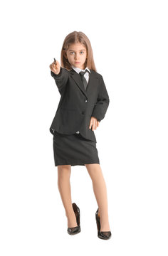 Little businesswoman pointing at viewer on white background