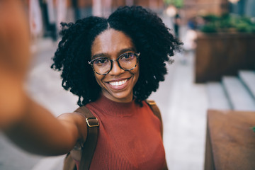 Young smiling black woman standing in street