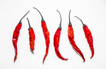 dried red chilli or chili cayenne pepper isolated on white background