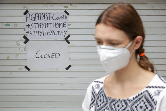 Small business owner in front of closed shop. Bankrupt business due to coronavirus(covid-19) outbreak.
