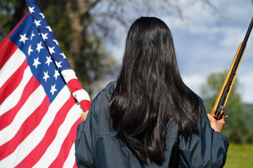Mexican Woman's Back, Holding American Flag and Rifle in Hands