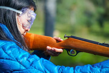 Female Taking Rifle Shooting Lessons Outdoors, Closeup