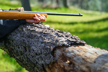 Rifle Stock and Hand, Closeup Outdoors
