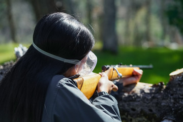 Woman Aiming Rifle On Forest Hunting Trip Wall mural