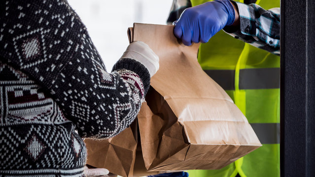 Courier brought a bag of food to an elderly woman home