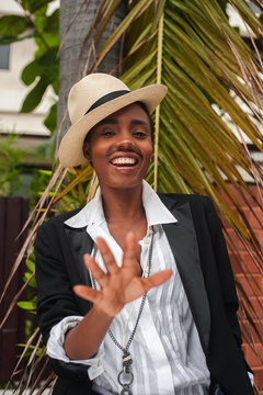 african girl with drawn mustache disguised as a man, cuba havana style.
