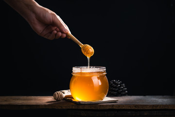 Honey in a glass jar,Scoop the honey in a glass jar