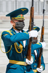 Kyrgyz servicemen wearing protective masks take part in the ceremony of guards' changing in Bishkek