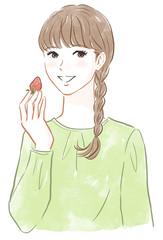 イチゴを持った女性