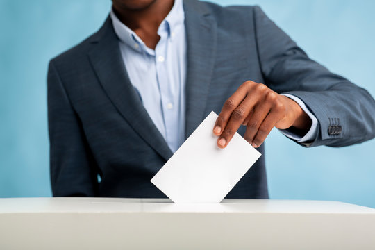 African Man throwing his vote into the ballot box