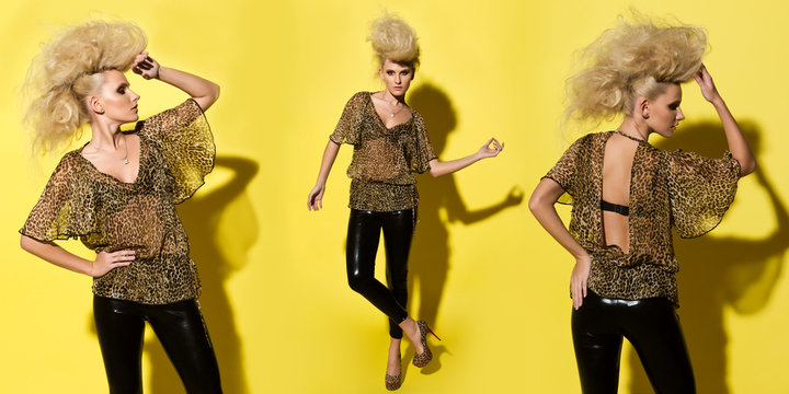 Stylish beautiful woman in an animal print see through blouse and shiny leather black pants on yellow background..