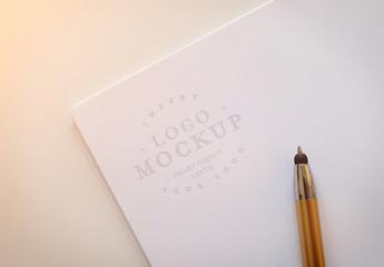 Debossed Logo on Paper Stack Mockup
