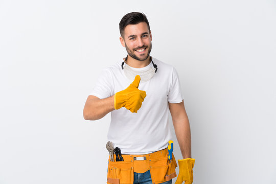 Craftsmen or electrician man over isolated white background giving a thumbs up gesture