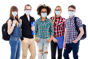 pandemic, health care and education concept - large set of teenagers or students in protective masks standing isolated on white