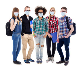 corona virus, pandemic, health care and education concept - group of teenagers or students in protective masks standing isolated on white