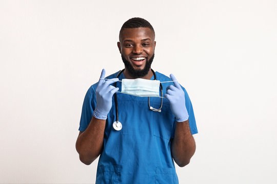 Positive african male doc wearing face mask