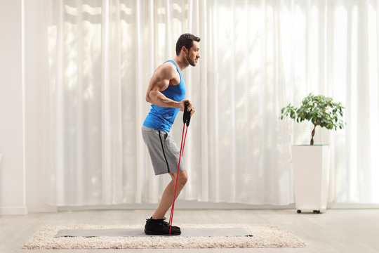Man exercising with a resistance band at home