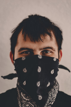 Stay home and isolate yourself watchword. Man in mask asks to stay at home. Quarantine spring 2020, coronavirus covid-19. City lock down. Be healthy. Self distancing. Self isolation. Word slogan