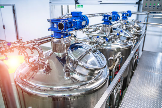 Dairy factory with milk pasteurization tank and pipes