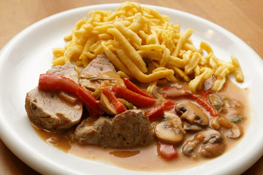 pork tenderloin with spaetzle, champignons and paprika