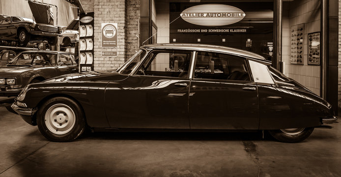 BERLIN, GERMANY - MAY 17, 2014: Mid-size luxury car Citroen DS 18. Sepia. 27th Oldtimer Day Berlin - Brandenburg