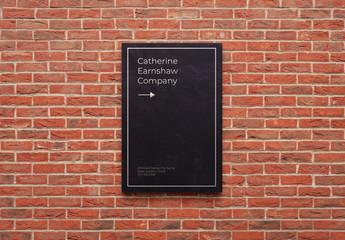 Black Plastic Sign on Brick Wall Mockup