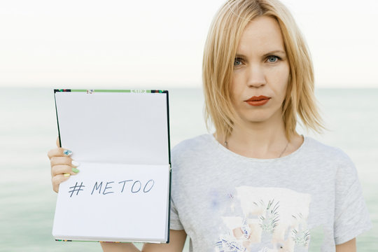 A woman is holding a metoo inscription.